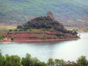 Salagou lake - Reservoir, former volcano crater, red cliff and trees