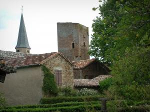 Salles - Trees, hedges, stone houses, keep and church bell tower of the village