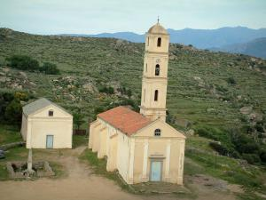 Sant'Antonino - Church with its bell tower and hills in background