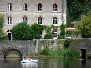 Sarthe valley - Facade of the old Marble manufactory in Solesmes, and vacationers in a pedal boat on River Sarthe