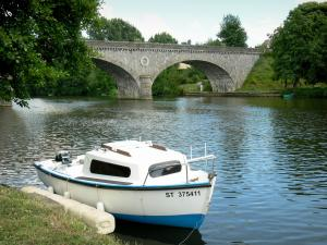 Sarthe valley - Moored boat and Solesmes bridge spanning over River Sarthe