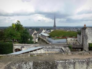 Saumur - Fortification (wall) of the castle with view of the bell tower of the Saint-Pierre church and the houses of the city