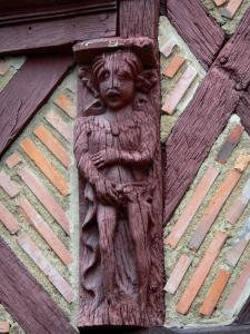 Saumur - Wooden character carved on a facade of an period house