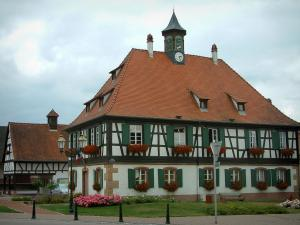 Seebach - White half-timbered house (town hall) with flower-bedecked windows (geraniums)