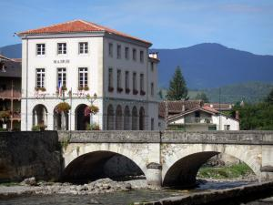 Seix - Town hall, houses of the village and bridge spanning River Salat; in Le Couserans area, in the Ariège Pyrenees Regional Nature Park