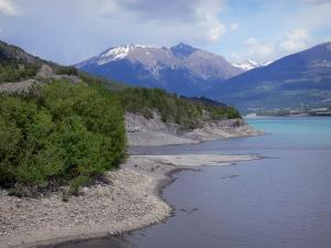 Serre-Ponçon lake - Water reservoir (artificial lake), shores planted with trees and mountains