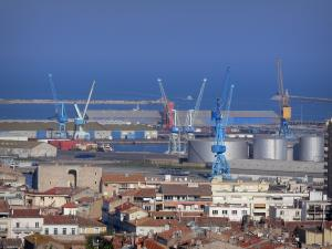 Sète - Roofs of houses and buildings of the city and the commercial harbour with its cranes