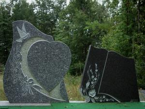Sidobre - Granite gravestones and forest in background in the Upper Languedoc Regional Nature Park