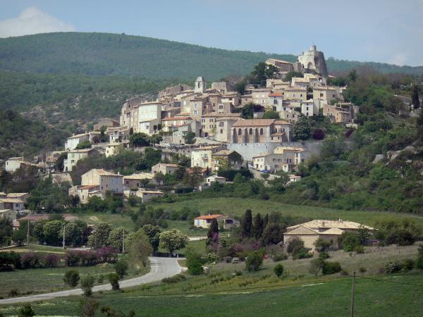 Simiane-la-Rotonde - Hilltop Provençal village its rotunda (keep of the medieval castle), its Saint-Jean bell tower, its Sainte-Victoire church, its houses and its surrounding hills