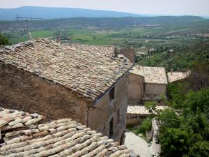 Simiane-la-Rotonde - View of the roofs of the village and surrounding hills