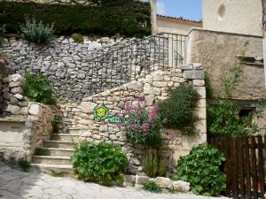 Simiane-la-Rotonde - Stone walls bordering the stair of a house