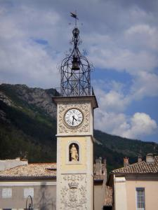Sisteron - Clock tower topped by a forged iron campanile (bell tower) and houses of the old town