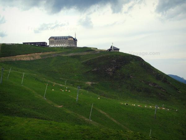 Superbagnères - Buildings, chapel and ski lifts of the ski resort, cows in meadows, in the Pyrenees