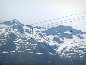 Superbagnères - Chairlift (ski lift) of the ski resort and the Pyrenees mountains with some snow
