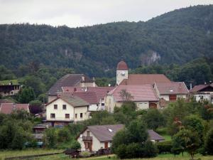 Syam - Church bell tower and houses of the village, trees and forest