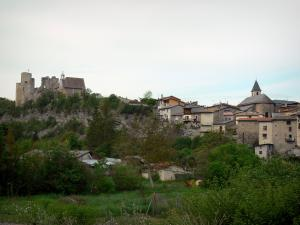Tallard - Medieval castle on its rocky spur, bell tower of the Saint Grégoire church, houses of the village and trees