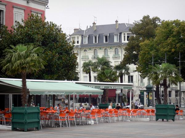 Tarbes - Verdun square, café terrace, potted palms, trees and buildings of the town