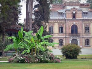 Tarbes - Massey garden (English landscape park): facade of the Massey museum, bandstand, banana trees, flower beds, lawns and trees