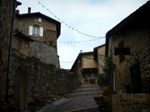 Ternand - Narrow street in stair lined with houses in the Pierres Dorées (golden stones) area