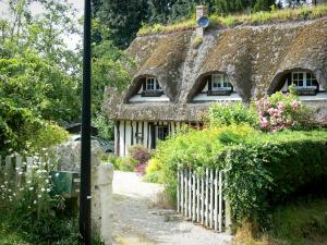 Thatched Cottage Route - Half-timbered house with a thatched roof, and its flower garden; in Vieux-Port, in the Norman Seine River Meanders Regional Nature Park