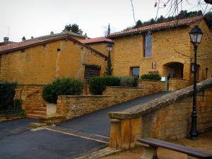 Theizé - Town hall, houses in the village, street, lampposts and bench in the Pierres Dorées (golden stones) area
