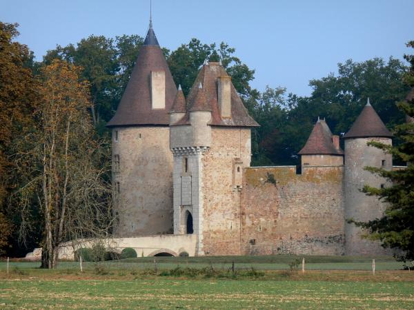 Thoury castle - Gateway (gatehouse) and towers of the castle surrounded by trees; in the town of Saint-Pourçain-sur-Besbre, in the Besbre valley