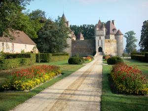 Thoury castle - Driveway lined with flowers and shrubs, leading to the castle; in the town of Saint-Pourçain-sur-Besbre, in Besbre valley