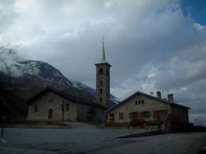 Tignes - Church of the ski resort, mountain and cloudy sky (peripheral zone of the Vanoise national park)