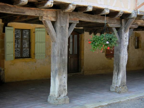 Tillac - Wooden pillars of an old house in the fortified village