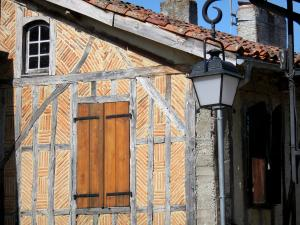 Tillac - Facade of a half-timbered house and lantern
