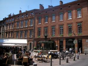 Toulouse - Houses, restaurants terraces and fountain of the Roger-Salengro square