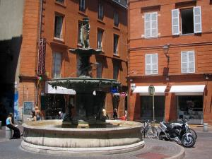 Toulouse - Houses and fountain of the Roger-Salengro square