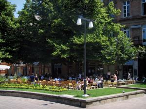 Toulouse - Restaurants terraces, trees and houses of the Saint-Georges square