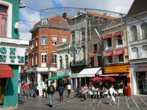 Tourcoing - Pedestrian street, houses, shops and café terrace