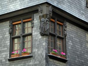 Tours - House of the old town with wooden sculptures on windows