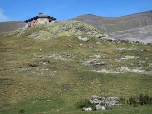 Troumouse cirque - Stone house, lawn and mountain in the Pyrenees National Park