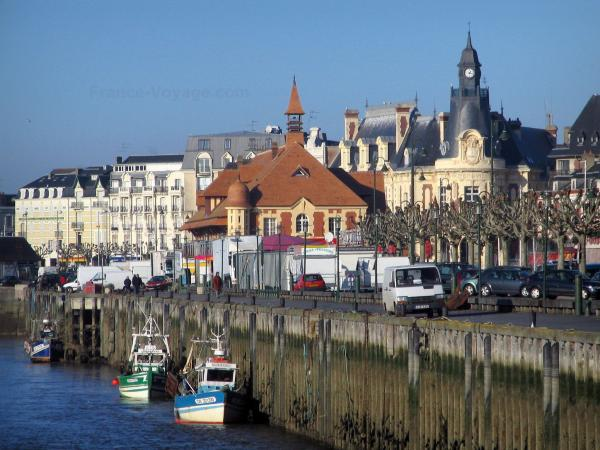 Trouville-sur-Mer - Côte Fleurie (Flower coast): buildings of the seaside resort, one home to the town hall, and moored trawlers
