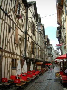 Troyes - Narrow paved street lined with cafe terraces and old timber-framed houses