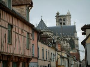Troyes - Houses with the pastel-colored facades and the tower of the Saint-Pierre-et-Saint-Paul cathedral in background