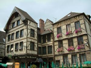 Troyes - Old timber-framed houses and parasols of a café terrace