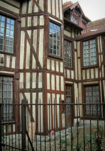 Troyes - Wooden building with its rosebush (roses) and its forged iron fence