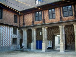 Troyes - Mauroy mansion of the Renaissance style (the Tool and Labor Thought house): facade of the inner courtyard with Champagne checkerboard (brick and chalk), columns and festive decoration