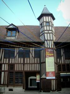Troyes - Mauroy mansion of the Renaissance style (the Tool and Labor Thought house): facade of the inner courtyard with turret, timber framings and festive decoration