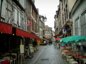 Troyes - Street paved with houses (some half-timbered), restaurant terraces and shops