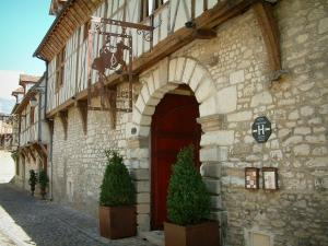 Troyes - Facade of a residence (mansion), stone and half-timberings, decorated with a forged iron banner