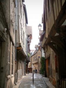 Troyes - Narrow street paved with old timber-framed houses, Mauroy mansion (Tool and Labor Thought house) in background