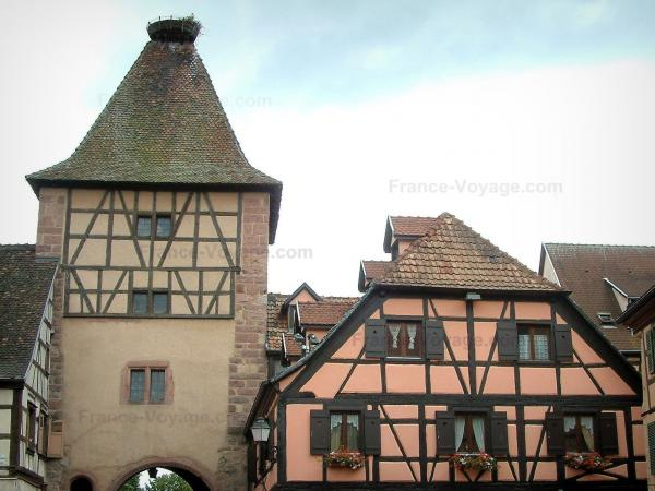 Turckheim - Gateway with a storks nest and half-timbered houses