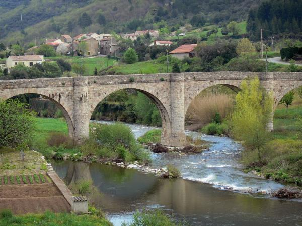 Upper Languedoc Regional Nature Park - Bridge spanning the river, houses of a village and trees