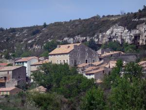 Upper Languedoc Regional Nature Park - Houses of a village, rock faces and trees