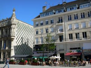 Valenciennes - Town hall, building and cafe terraces of the Armes square